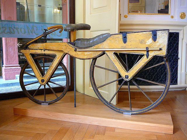 "Early bicycle known as a Laufmaschine, which means ""running machine."" This one was built around 1820"