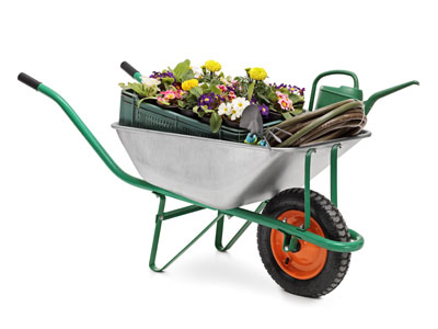 How does a wheelbarrow help you carry heavy loads?