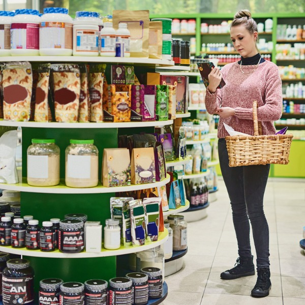 Woman looking at a product label