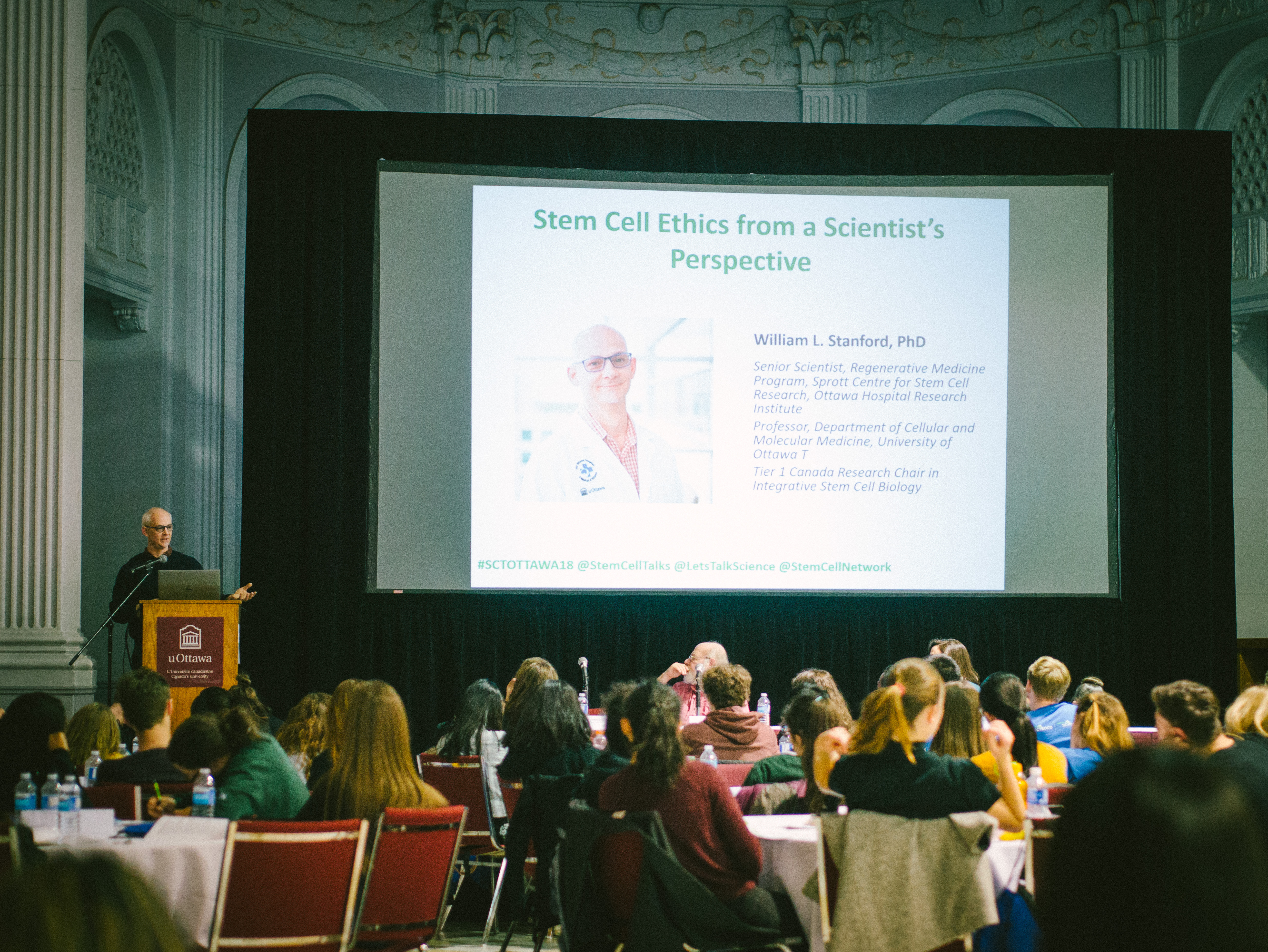 William L. Stanford presenting to group of youth on stem cell ethics