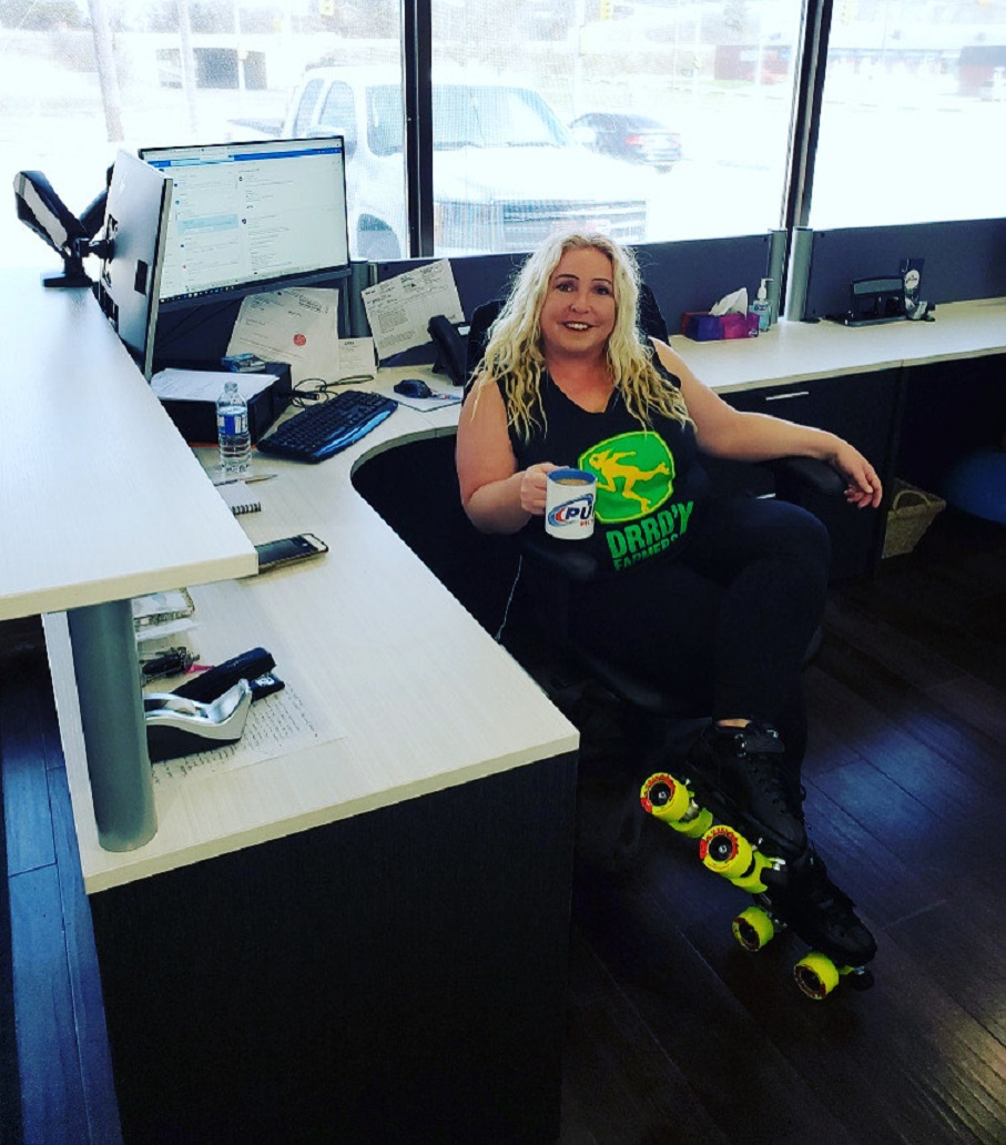 Tara Boyd in office wearing roller skates