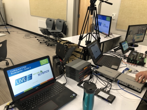 Computers and sound equipment set up for broadcast