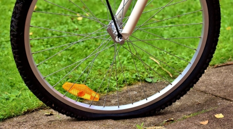 A bicycle tire that is getting flat
