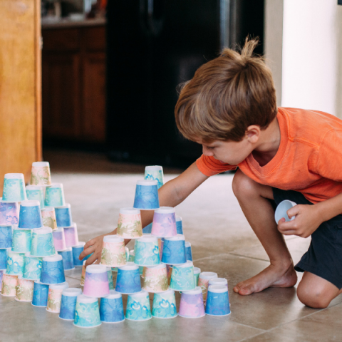 Child stacks cups