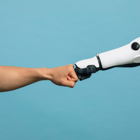 Robot and human fist bumping