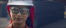 Worker wearing a construction hat and goggles