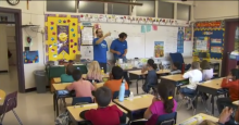 Outreach volunteers presenting to an elementary school class