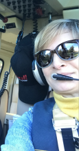 Catherine Roome in helicopter