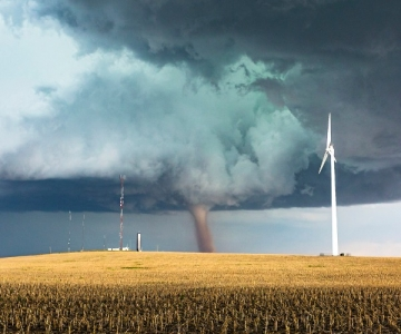 dangerous tornado approaching wind turbine