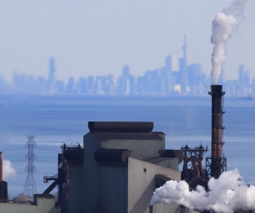 Hamilton, Ontario industrial area with Toronto skyline in the background