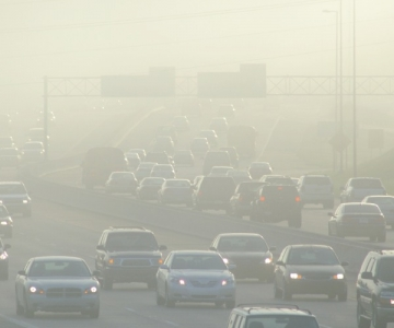 Cars driving through thick smog