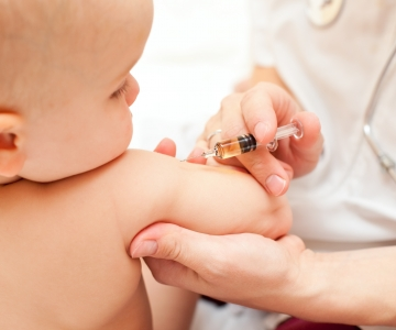 Infant receiving a vaccination