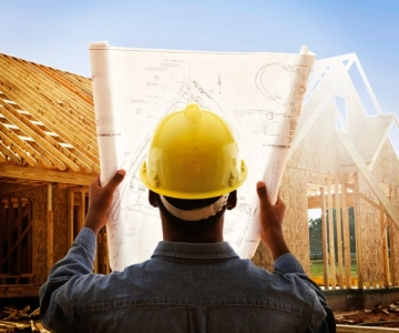 Construction worker with house plan
