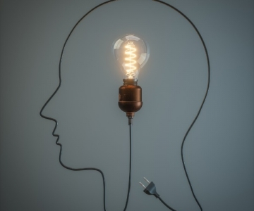 Light bulb and cord in shape of a head