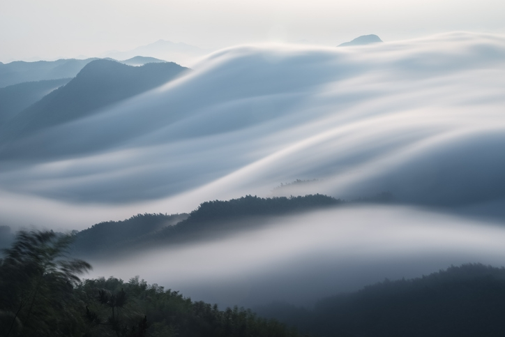 Clouds flowing over a mountain range