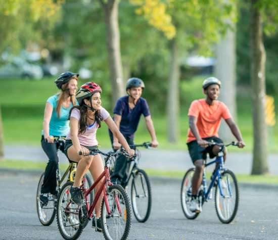 A group of teens riding bicycles. Image © FatCamera, iStockphoto.com