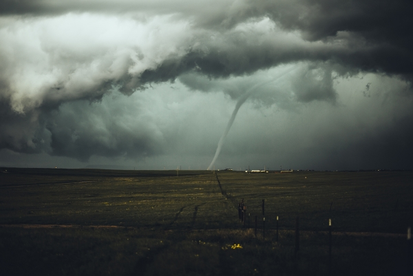 Funnel-shaped tornado seen in the distance