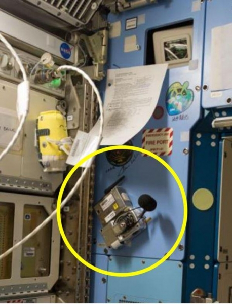A noise dosimeter installed on a wall of the International Space Station