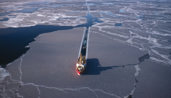 Icebreaker ship pushing its way through the sea ice