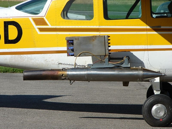 Cloud-seeding equipment attached to the side of a small aircraft