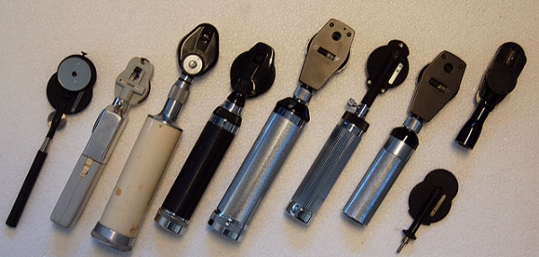 Several different handheld ophthalmoscopes
